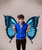 Handsome young man with butterfly blue illustration on the back Stock Images