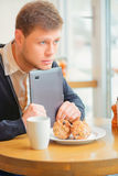 Handsome young man in cafe Royalty Free Stock Photography