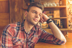 Handsome young man at cafe Stock Image