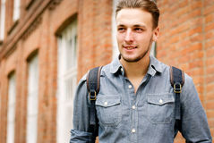 Handsome young man carrying a backpack Royalty Free Stock Photo