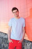 Handsome young man in casual clothes smiling outdoors Stock Photos