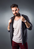 Handsome young man in casual outfit. Studio shot Stock Photo