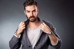 Handsome young man in casual outfit. Studio shot Royalty Free Stock Images