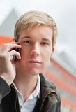 Handsome young man with cellphone Royalty Free Stock Images