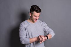 Handsome young man checking hand watch time Stock Image
