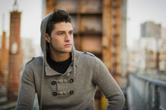 Handsome young man in city setting, industrial Stock Images