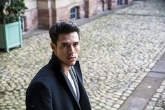 Attractive young man in urban setting in Europe stock photography