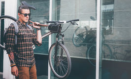 Handsome Young Man Ciyclist With Glasses Carries Bicycle On His Shoulder Street Daily Routine Lifestyle Royalty Free Stock Photos