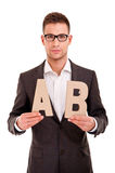 Handsome young man in classic suit and with letters abc Royalty Free Stock Images