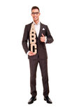 Handsome young man in classic suit and with letters abc Royalty Free Stock Image