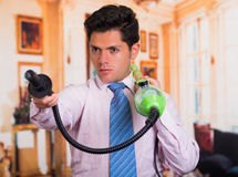 Handsome young Man cleaning home with vacuum cleaner in his shoulder Royalty Free Stock Photos