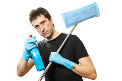 Handsome young man with cleaning supplies Royalty Free Stock Images