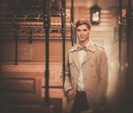 Handsome young man in coat Stock Photography