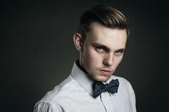 Handsome young man with cold gaze Stock Photo