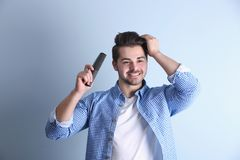 Free Handsome Young Man Combing Hair Royalty Free Stock Photo - 115949415