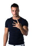 Handsome young man counting to four with fingers and hands Royalty Free Stock Images