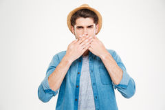 Handsome young man covered his mouth by hands Royalty Free Stock Photography