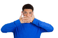 Handsome young man covering mouth , speak no evil concept Stock Image