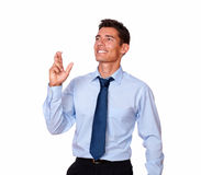 Handsome young man crossing his fingers Stock Image