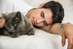 Handsome Young Man Cuddling his Gray Cat Pet Royalty Free Stock Images