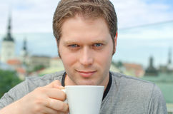Handsome young man with cup Royalty Free Stock Photography