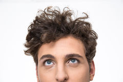 Handsome young man with curly hair looking up Royalty Free Stock Photo