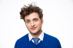 Handsome young man with curly hair. Over gray background stock image