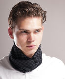 Handsome young man with curly hairstyle. Stock Image