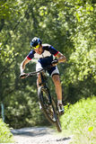 Handsome young man cycling in the mountain. Royalty Free Stock Photography