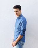 Handsome young man in denim blue shirt staring Stock Photos