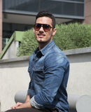 Handsome young man with denim shirt and sunglasses Stock Photo