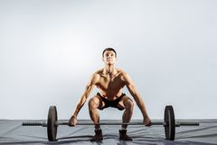 Handsome young man doing exercises in the gym. The concept of fitness, sports and a healthy lifestyle stock photos