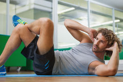 Handsome young man doing fitness exercise Stock Photos