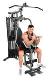 Handsome young man doing lateral pull-down workout isolated on white Stock Images