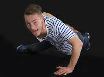 Handsome young man doing single hand push-ups Royalty Free Stock Image