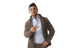 Handsome young man doing victory sign with hand Royalty Free Stock Images