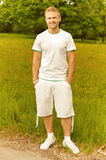 Handsome young man dressed in white Royalty Free Stock Photo