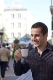 Handsome young man drinking coffee Stock Image
