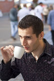 Handsome young man drinking coffee Stock Photos