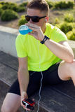 Handsome young man drinking after running. Royalty Free Stock Image
