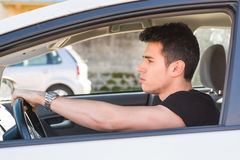 Handsome Young Man Driving a Car Stock Image