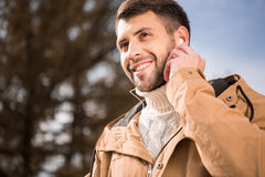 Handsome young man in earphones Royalty Free Stock Images