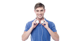Handsome young man with earphones Stock Image