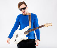Handsome young man with electric guitar Stock Images