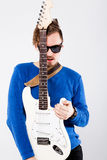 Handsome young man with electric guitar Stock Photo