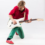 Handsome young man with electric guitar Royalty Free Stock Photos