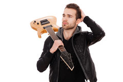 Handsome young man with an electric guitar Royalty Free Stock Photography