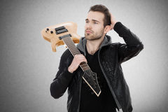 Handsome young man with an electric guitar Royalty Free Stock Images