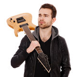 Handsome young man with an electric guitar Stock Photos