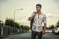 Handsome young man in elegant white shirt standing Royalty Free Stock Image